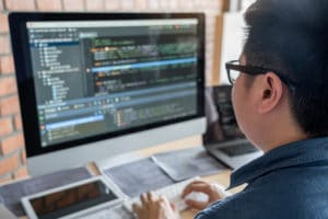 web developer working on code to build a custom website